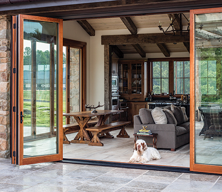 VistaLuxe folding door with Coal Black exterior finish and panels stacked open to one side.