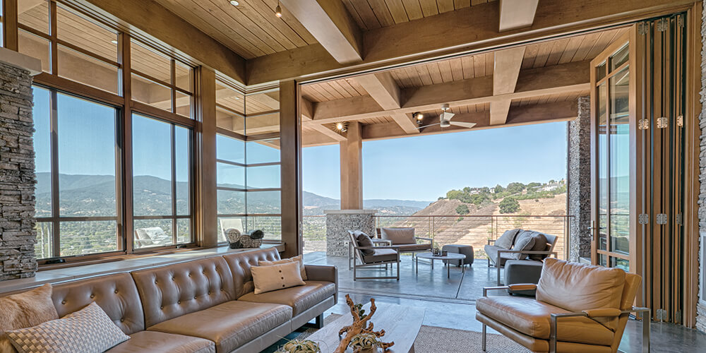 Custom-crafted wood folding doors embrace breathtaking views of the landscape. AA528