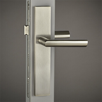 Brass Atlas Lever with City Backplate in Satin Nickel