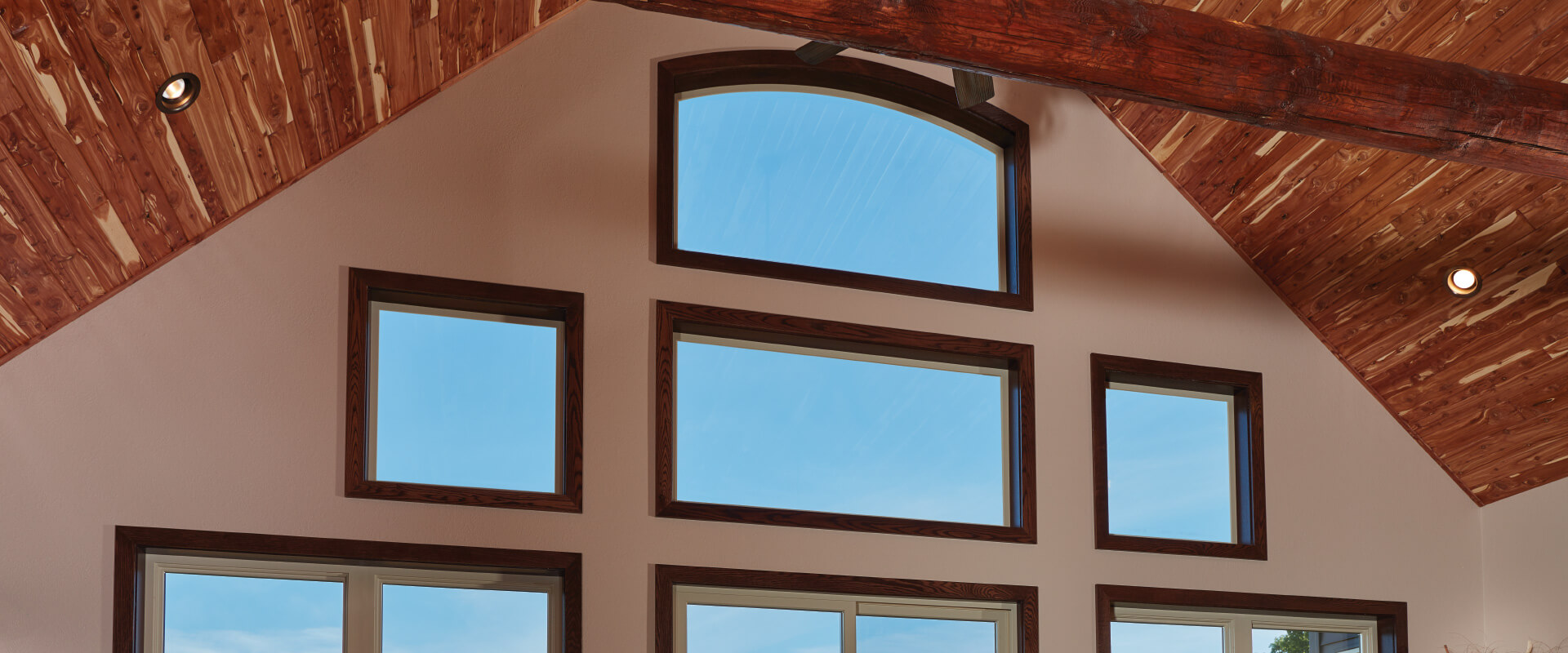Forgent Series direct set and radius windows with a wood interior.