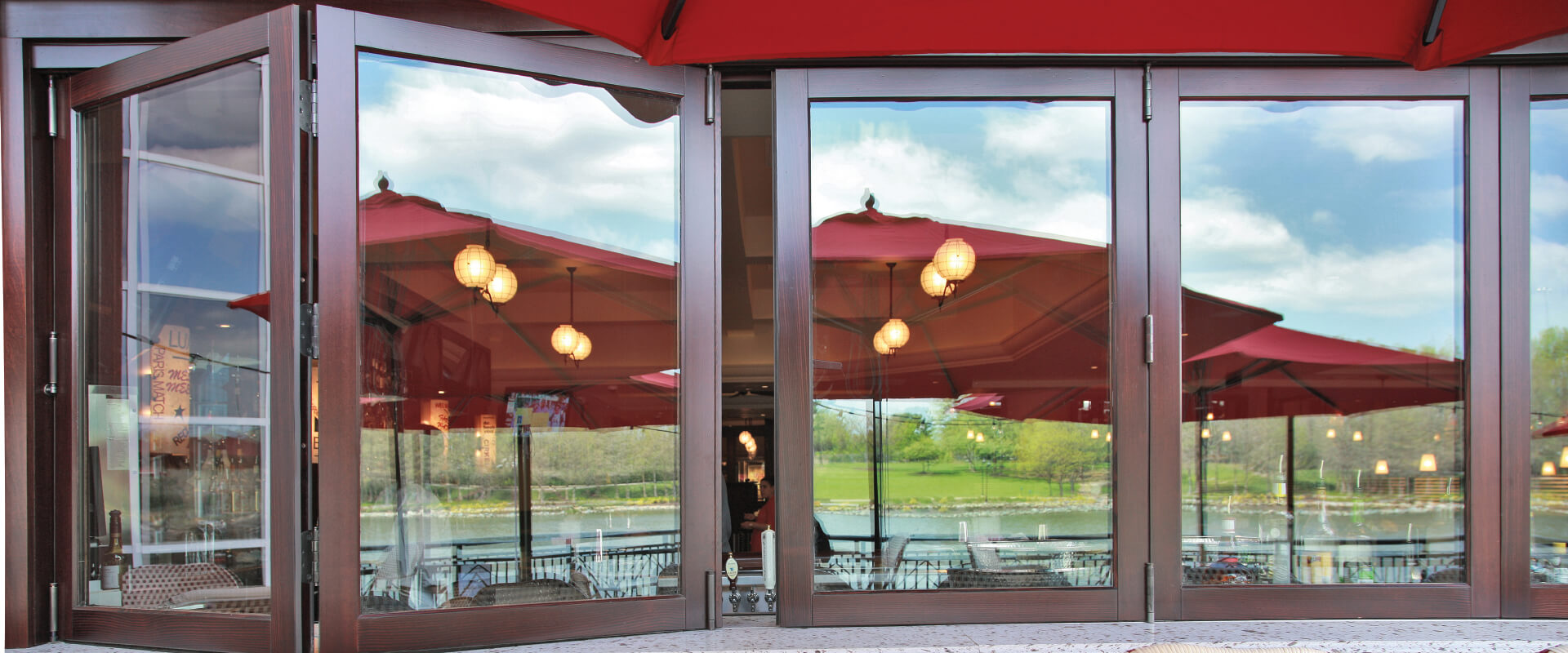 Heritage Series folding window with Mahogany wood exterior Cafe Deluxe street restaurant