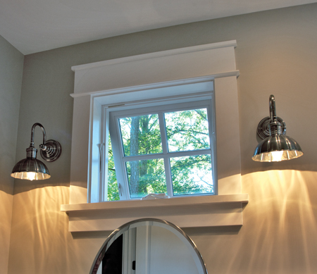 A single Ultra Series awning window cranked open over a bathroom sink.