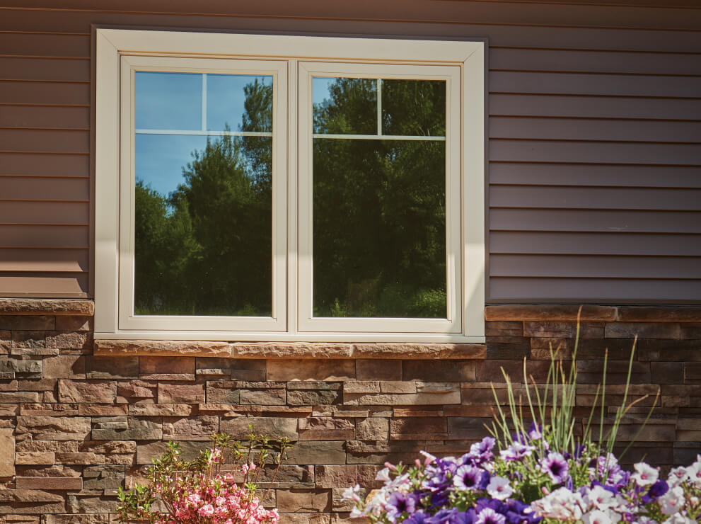 Forgent Series twin crank-out casement window with a Cloud exterior color that is integral to the Glastra material.