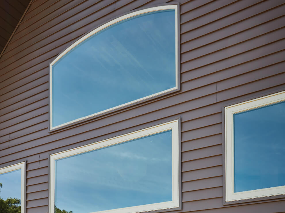 Forgent Series radius and direct set windows with a Cloud exterior color that is integral to the Glastra material.