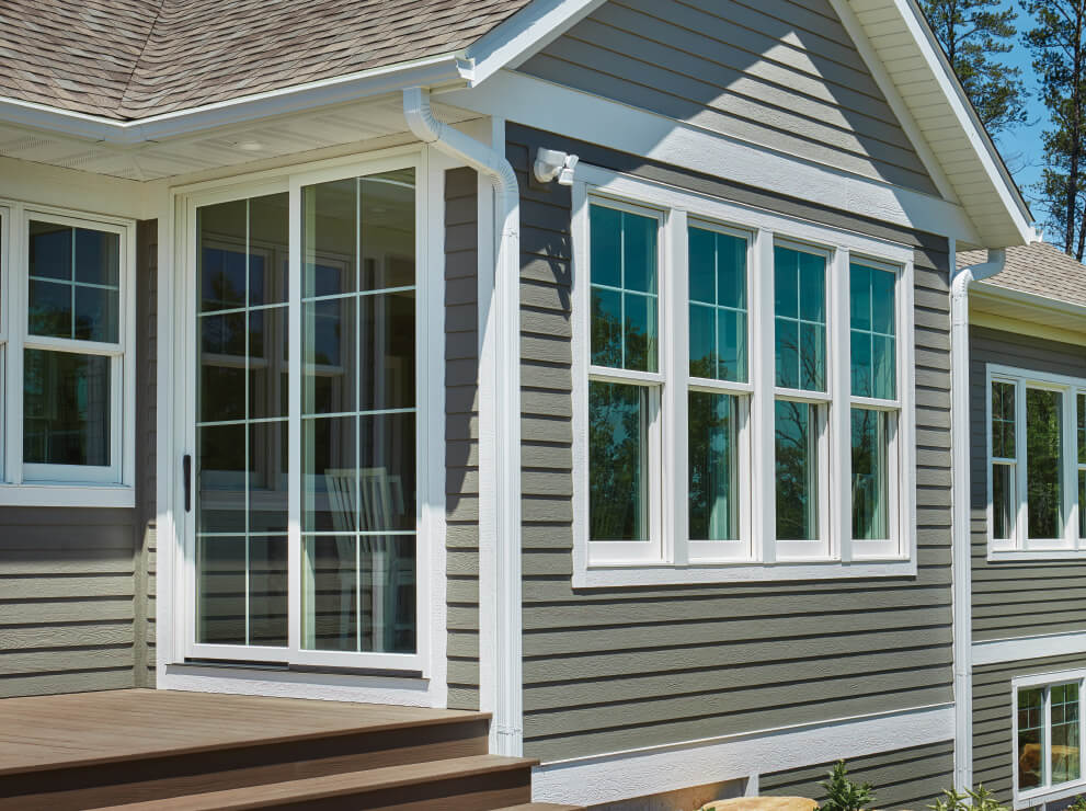 Forgent Series Double Hungs And A Sliding Patio Door With Grilles In The