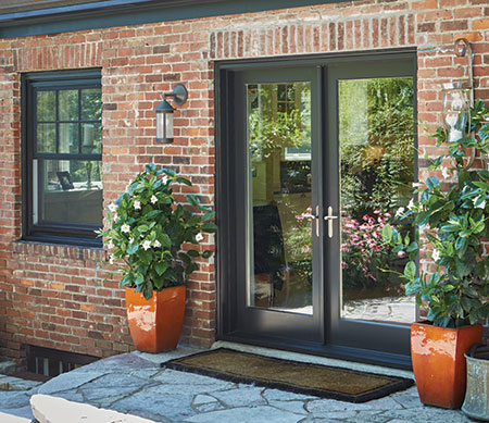 Forgent Series crank-out casements and swinging patio doors with a Cloud exterior color that is integral to the Glastra material.