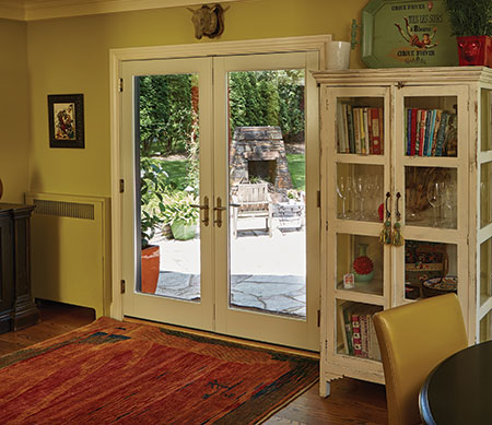Forgent Series swinging patio doors with a Cloud interior color that is integral to the Glastra material.