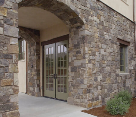 Heritage Series commercial French doors with Bay Leaf exterior finish and PDL bars.