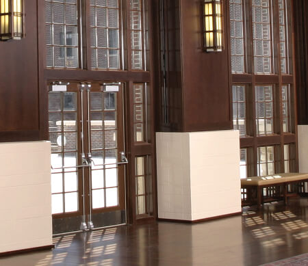 Ultra Series custom outswing commercial doors and studio windows.