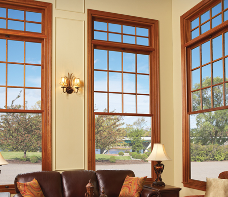 Majesta Double Hung windows with transoms stacked above. The top sash and transoms have divided lites.