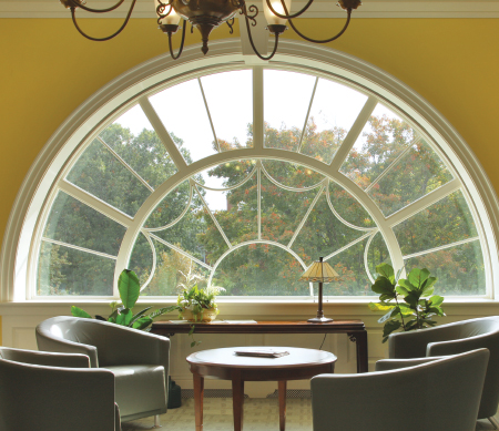 Ultra Series custom ogee direct set windows mulled around a half-circle radius with PDL bars.