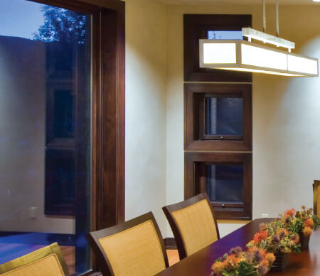 Ultra Series push-out awning windows with Alder interior wood and Oil-Rubbed hardware.