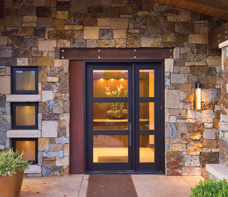 Ultra Series inswing French entrance doors with Dark Bronze anodized exterior finish, and wide cross rails.