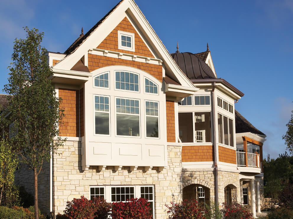 Ultra Series casements, radius top segment head windows with Abalone exterior finish.