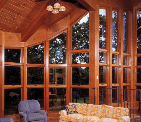 Ultra Series crank-out awnings and geometric windows in a rustic great room.