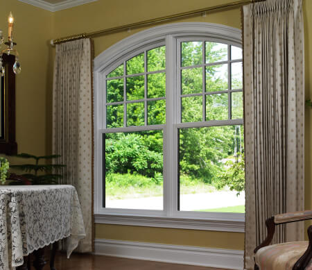 Ultra Series twin segment head Sterling double hung window with white hardware and PDL bars in the top sash.
