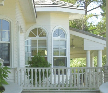Heritage Series Traditional double hung windows with half-circle transoms.