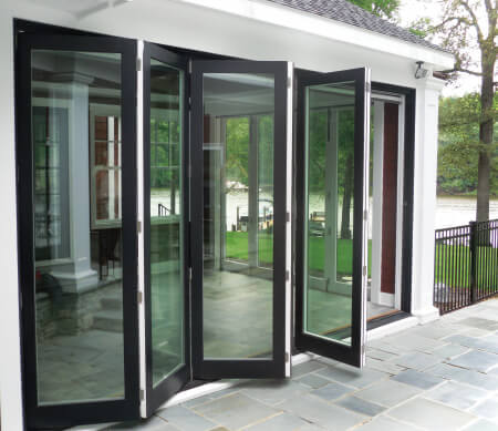Ultra Series folding doors with Coal Black exterior finish and Satin Nickel hardware.