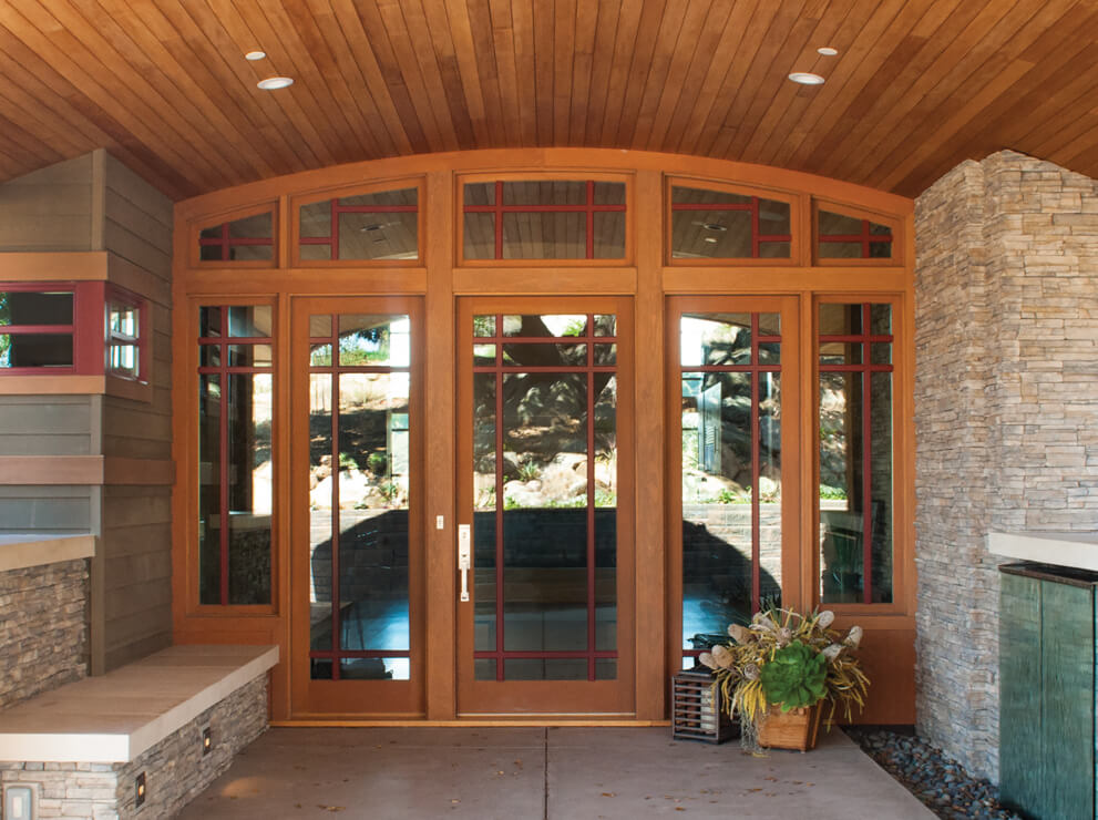 Heritage Series Craftsman style entrance door with beveled glass and raised panels.
