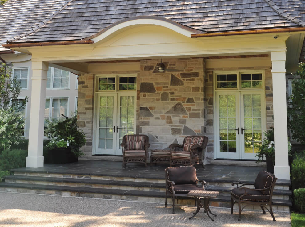 Heritage Series French inswing patio doors with transoms above.