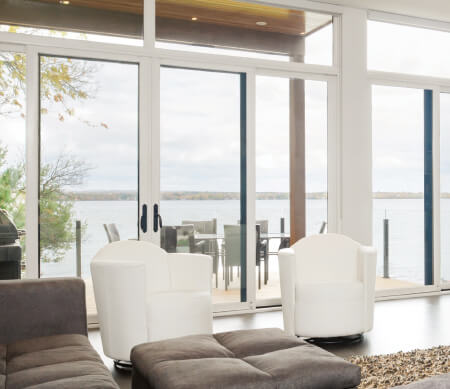 Ultra Series multi-slide doors mulled with stationary panels.