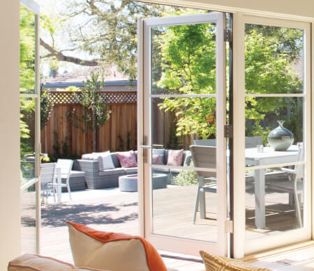 VistaLuxe three-wide outswing patio door unit with Satin Nickel hardware and PDL bars.