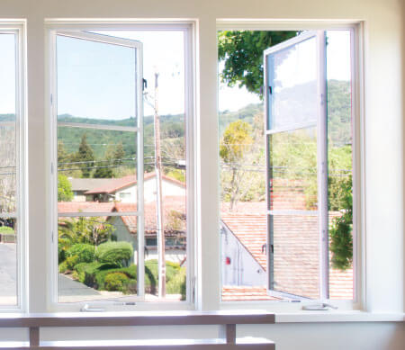 VistaLuxe Collection crank-out casement windows with white hardware and PDL bars.