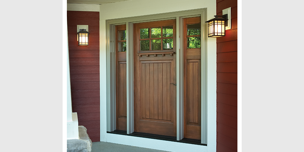 The Rich Wood Siding White Trim And Soft Glow Of Outdoor Porch Lights Make This Handcrafted Door Even More Inviting