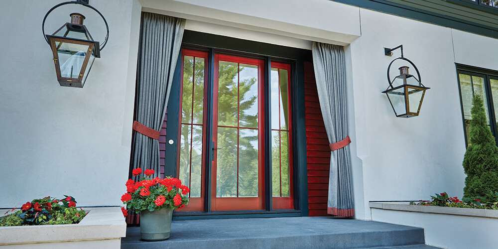 This Bold Entrance Features Sleek Gl Doors With A Pairing Of Red And Deep Black The Contrasting Colors Addition Pull Back Curtains Give